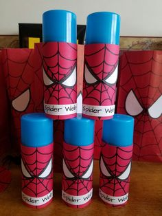 Made these spiderman Web shooters from dollar store silly string. Drew spiderman on card stock and printed out the words. I used card stock for the eyes and went around them in sharpie.