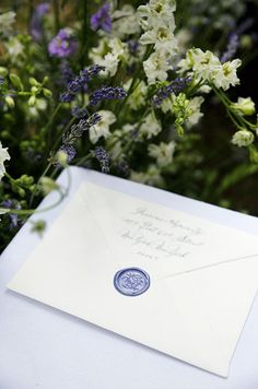 Under wildflowers, a hand calligraphed wedding invitation by Bernard Maisner is adorned with a monogrammed wax seal. Diy Invitations, Invitation Design, Invitation Ideas, Next Wedding, Dream Wedding, Wedding Stationery Inspiration, Themes Photo, Tuscan Wedding, Wedding Preparation