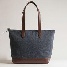 Nicola is a mid-sized tweed handbag from Emma Cornes. Made in Britain from Scottish tweed and full-grain leather, she's only available online.