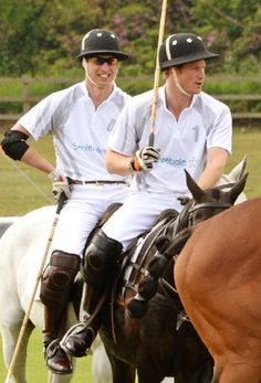 Prince William (L), Duke of Cambridge, and Prince Harry play during day two of the Audi Polo Challenge at Coworth Park Polo Club on 01.06.2014 in Ascot, England