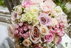 Pastel wedding bouquet of roses, bouvardia and gypsophila