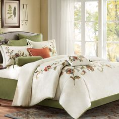 Complete any elegant bedroom with the Harbor House Madeline 4-piece comforter set featuring a multicolored floral design on an ivory background. Including a comforter, two shams and one bedskirt, this set is machine washable for easy care.