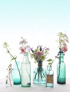 Mix of flowers and bottle shapes, sizes and colours