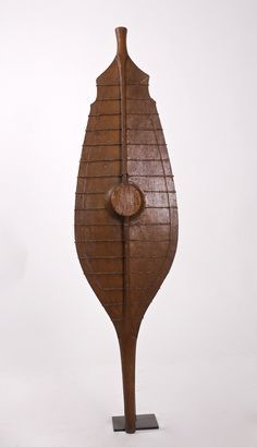 A classic, early, Nias shield. Light wood reinforced with rattan binding.