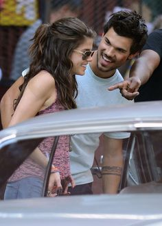 Is Taylor Lautner dating his co-star Marie Avgeropoulos? The two were spotted on the 4th of July canoodling in NYC!