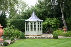 Small octagonal summerhouse by Garden Affairs
