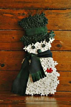 This little snowman made from repurposed puzzle pieces. SO many puzzles available at thrift stores.waiting for a new life like this. - would be a great family craft during christmas break Snowman Crafts, Crafts To Do, Christmas Projects, Holiday Crafts, Crafts For Kids, Puzzle Piece Crafts, Puzzle Art, Puzzle Pieces, Christmas Snowman