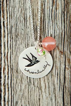 Eventually. A word we love to hate. So full of patience yet so full of hope. Can you see the little heart detail inside this dove of peace? It's adorable. This hand stamped Sterling silver necklace fe
