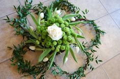 Natural eco funeral flowers - Biodegradable funeral tributes - using seasonal flowers, constructed on a base made out of willow and dog wood and secured with natural twine.