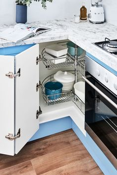 Coastal breeze - L shaped kitchen with light blue paint your own door cabinets. Available at Bunnings. Light Blue Paints, L Shaped Kitchen, Diy Kitchen Storage, Can Design, New Kitchen, Building Design, Storage Solutions, Easy Diy, Shelves
