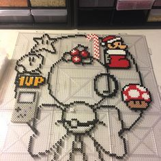 Current project. But it's bedtime. #perler #perlerbeadart #perlerart #perlerbeadcreations #perlerbeads #perlers #mario #kirby #nintendo #christmas #wreath
