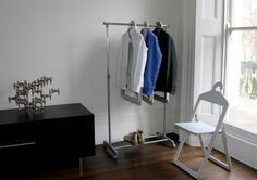 add hangers to folding chairs for easy storage