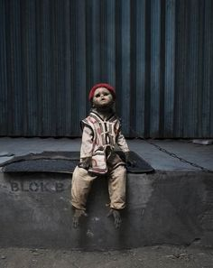 """""""A kind of you"""", a disturbing series about the world of street monkeys in the city of Jakarta, created by the Finnish photographer Perttu Saska. Trained and dressed as humans to ask for money to passersby, as is an old Asian tradition, these monkeys have now become real objects, even wearing doll heads to accent mimicry, turning them into real living toys… A cruel phenomenon that leaves a strong sense of unease…."""