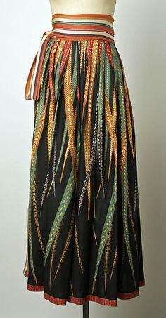 Multi-color print maxi-skirt, by Giorgio di Sant'Angelo, American, spring/summer 1987. Worn with black wrap blouse and olive green spandex skirt.