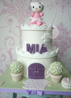 Hello Kitty castle birthday cake by The Designer Cake Company, via Flickr