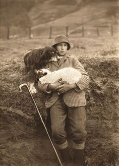 Heartwarming Vintage photo of a shepherd holding a lamb while his dog leans on h. - Heartwarming Vintage photo of a shepherd holding a lamb while his dog leans on his shoulder. Antique Photos, Vintage Pictures, Vintage Photographs, Old Pictures, Vintage Images, Photo Vintage, Vintage Dog, The Good Shepherd, Shepherd Dog