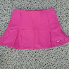 NWOT Hot Pink Nike FitDry Skort Never worn, just tried on! True color is like a hot pink/magenta, much brighter than the pictures show! Size small :) Nike Skirts