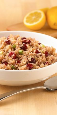 A side dish quinoa recipe flavored with dried cranberries and green onions for a great accompaniment for chicken or pork
