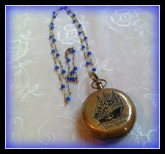 PLEASE NOTE THIS IS EXCLUDED FROM ALL SALES AND DISCOUNT CODES. FULL PRICE PAID ONLY. THANKS Compass Pendant Charm with Engraved Nautical Closing Lid REALLY WORKS Compass Nautical Antique Bronze. � Material: Glass, Brass� Size: 45mm diameter� Color: Antique bronzeOn a long vintage 1mm thick gold Brass connected chain with 3mm Blue cat eye beads. The chain is approx 30'' long and does up with a copper lobster clasp. We post to UK and Ireland for FREE.We al...