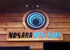 Carved and painted wood sign for Nosara Mtb-Surf Surf Logo, Nosara, Painted Wood Signs, Mtb, Painting On Wood, Surfing, Logo Design, Boards, Surf