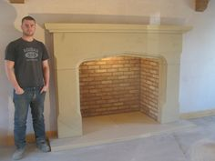 This claims to show the correct scale for a fireplace. The sandstone and brick against white walls are a lovely combination.