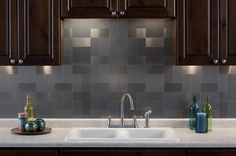 Ethan wanted to do these tiles for our backsplash and I didn't like the idea, but this kinda looks cool. Especially with the cabinet lighting.