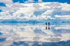 "Salar de Uyuni, located in southwest Bolivia, is often dubbed the ""Mirror of the Sky."" It is so boundless and bright white that Neil Armstrong is said to have mistaken it for an enormous glacier seen from space. Uyuni Bolivia, Bolivia Salt Flats, Places To Travel, Places To Visit, Flat Picture, Local Tour, Sky And Clouds, Natural Wonders, Far Away"