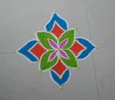 Dots Rangoli A very easy and simple dots rangoli, using straight dots. For Navartri have used all bright colours to this. Small Rangoli Design, Rangoli Kolam Designs, Rangoli Designs With Dots, Kolam Rangoli, Easy Rangoli, Beautiful Rangoli Designs, Bright Colours, Simple Colors, Simple Rangoli With Dots