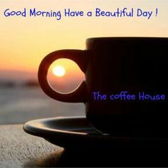 Good morning......./ photo with the sunrise showing through the handle of a coffee cup.