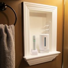 Remove Medicine Cabinets And Add A Built In Shelf, And Put An Outlet In