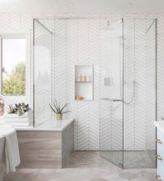 white bathroom Walk-in shower with floor to ceiling white herringbone tile + glass shower doors + spa like bathroom design White Bathroom Tiles, Spa Like Bathroom, Bathroom Tile Designs, Bathroom Interior Design, Bathroom Ideas, Bathroom Modern, Bathroom Organization, Bathroom Inspo, Bathroom Mirrors