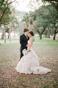 Blush feathered wedding dress: http://www.stylemepretty.com/2015/05/19/the-prettiest-blush-pink-wedding-dresses/ Photography: Landon Jacob - http://landonjacob.com/