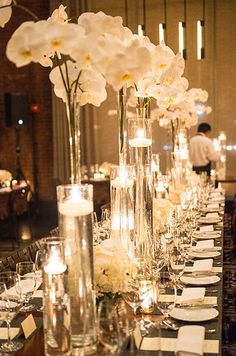 Orchids and floating votives in varying heights come together for a stunning tablescape.