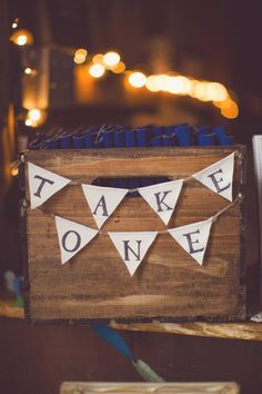 """Beer koozie wedding favors displayed in a stained wood crate, complete with a muslin/twine """"take one"""" sign. ~Signed by Soden"""