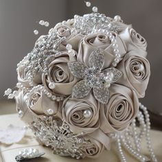 Champagne & Chocolate Round Crystals & Satin Floral Large Bouquet    *** UNIQUE 1 OF A KIND COUTURE COLLECTION ***          This Champagne & Chocolate Satin Flower & Crystals Brooches design with cascading pearl strands is so vintage chic! A gorgeous arrangement of Swarovski Pearls, Satin Champagne coloured flowers with floral crystals brooches is just stunning. AUD$440 www.elavonza.com @Bride.com.au @Bride to Be Magazine @Modern Wedding @Wedding Inspirasi