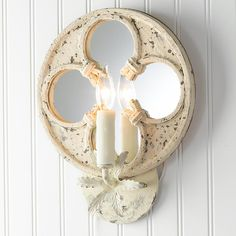 Find beautiful wall sconces in unique styles at Shades of Light! Shop classic wall lights like sconces with shades, and unusual wall sconces like pulley and shell sconces. Candle Sconces, Wall Sconces, Mirrors, Mirror With Lights, Wall Lights, Cream Candles, Quatrefoil, Beautiful Wall, Fabric Shades
