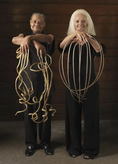 People with the longest finger nails. The woman didn't clip her nails since 1979. The man's nails were about 9 meters(about 30ft) long total.