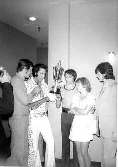 Elvis backstage at the Las Vegas Hilton in september 3 1973 wearing his white spanish suit.
