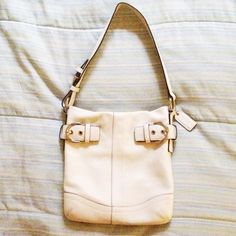 """Authentic Coach shoulder bag White Leather. Approx 9"""" by 9"""" and width is about 1"""".  Hardly used. Couple of minor stains as seen in the 4th pic but barely noticeable otherwise in great condition. Coach Bags Shoulder Bags"""