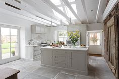 Light farmhouse kitchen with skylight and stone floor