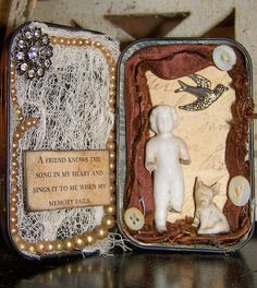 frozen charlotte tin | Distressed Tin Assemblage with Frozen Charlotte and Pet - a photo on ...