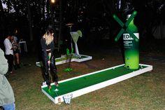 <p> An oversize Svedka bottle decor piece backed a mini golf activity.</p>
