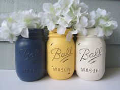 Set of 3 Ball Mason jars. Each jar is hand painted and distressed to give them a rustic vintage look. The jars are then finished with a