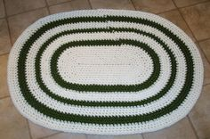 This beautiful rug is handmade from new cream and green chunky acrylic yarn. It would go well in your bathroom, bedroom or any room in your house. Rug measures 37 1/2 X 26 inches.  Made with care in a smoke free home.  Wash on delicate/gentle cycle. Lay flat to dry. Pat into shape.  Thanks for stopping by