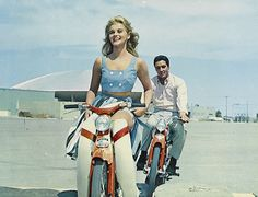 """Viva Las Vegas"" - Ann Margret and Elvis on their Honda motor scooters, with part of the camera platform visable bottom right."