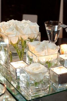 This is for the 10 round guest tables...We like the idea of the glass and candles. Flowers are a possibility and would be awesome, as long as they are not too expensive.