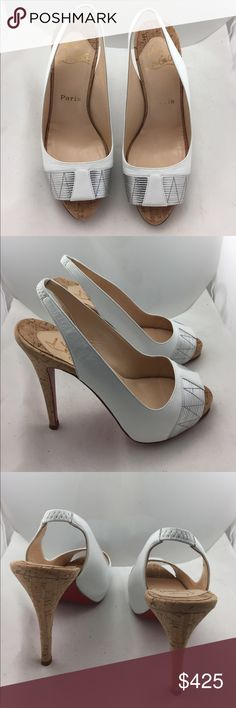 Christian Louboutin Pumps! These shoes are stunning.  White with silver accent at the toes.  Shoes are in excellent condition.   Only has some minor wear at bottom soles. Cork platform and heels. Christian Louboutin Shoes Platforms