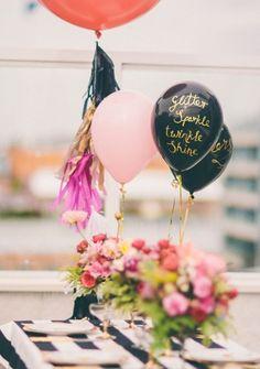 gold writing on black balloons