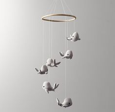This is darling ! Love this chambray whale mobile for nursery. A pod of chambray whales swims the imaginary seas from above. Suspended from a wood ring, they migrate smoothly with the breeze to the delight of whale watchers below.