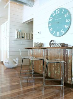Acrylic and steel bar stools...help create a visual openness next to a salvaged boutique store counter...beach style entry by Mina Brinkey